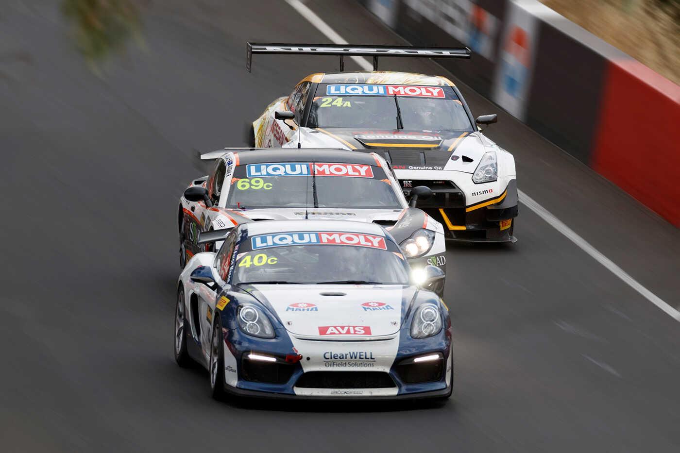 Brookspeed's yellow and blue Porsche Boxster 'S' race car Calum Lockie